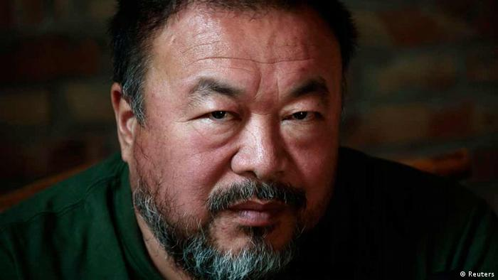 Dissedent Chinese artist Ai Weiwei reacts during a group interview at his studio in Beijing May 22, 2013. Ai made his first foray into the musical world on Wednesday with the release of the top single from his debut album, a song called Dumbass that takes inspiration from his detention in 2011. The video for the heavy metal song, which was directed by Ai with cinematography by acclaimed filmmaker Christopher Doyle, depicts Ai's 81 days in secretive detention in 2011, which sparked an international outcry. REUTERS/Petar Kujundzic (CHINA - Tags: POLITICS SOCIETY)