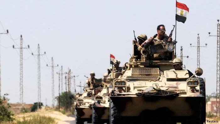 Soldiers in military vehicles proceed towards the al-Jura district in El-Arish city from Sheikh Zuwaid, around 350 km (217 miles) northeast of Cairo May 21, 2013. Egyptian army and police forces stepped up roadblocks in north Sinai in a hunt for militant Islamists who kidnapped seven security officers last week, a security source said on Tuesday. REUTERS/Stringer (EGYPT - Tags: POLITICS MILITARY)