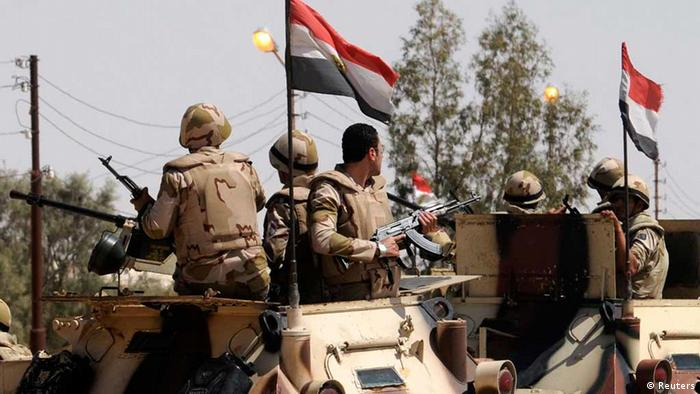 Soldiers in military vehicles proceed towards the al-Jura district in El-Arish city from Sheikh Zuwaid, around 350 km (217 miles) northeast of Cairo May 21, 2013. (Photo: REUTERS/Stringer)