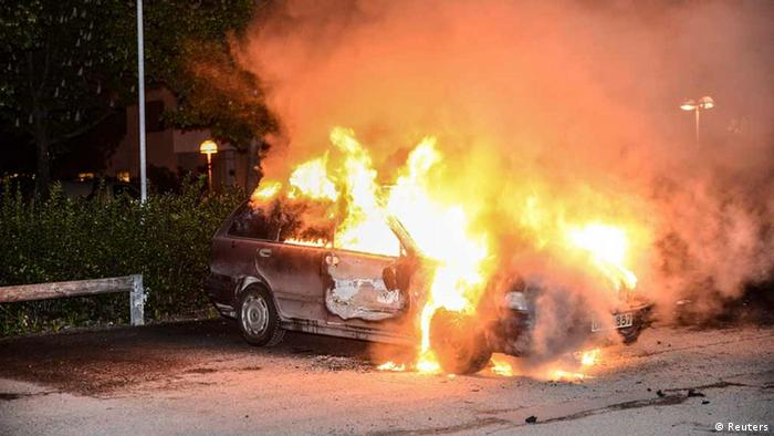 A car set on fire burns, following riots in the Stockholm suburb of Kista late May 21, 2013, in this picture provided by Scanpix. Sweden's capital has been hit by some of its worst riots in years after youths scorched dozens of cars, attacked a police station and threw stones at rescue services in its poor immigrant suburbs for a third night running. REUTERS/Fredrik Sandberg/Scanpix (SWEDEN - Tags: CIVIL UNREST POLITICS) ATTENTION EDITORS - THIS IMAGE HAS BEEN SUPPLIED BY A THIRD PARTY. IT IS DISTRIBUTED, EXACTLY AS RECEIVED BY REUTERS, AS A SERVICE TO CLIENTS. SWEDEN OUT. NO COMMERCIAL OR EDITORIAL SALES IN SWEDEN. NO COMMERCIAL SALES