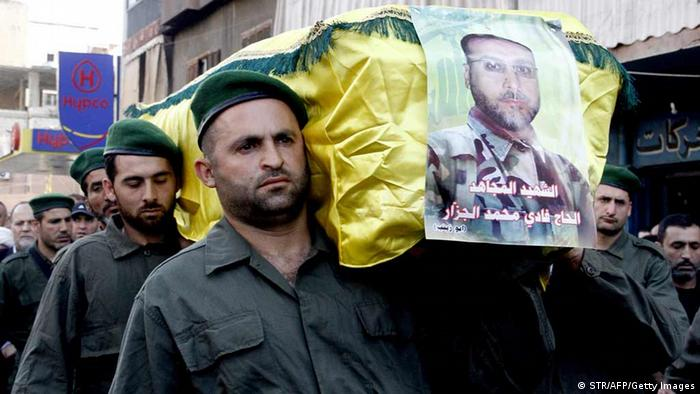 Members of Lebanon's Hezbollah carry a coffin STR/AFP/Getty Images)