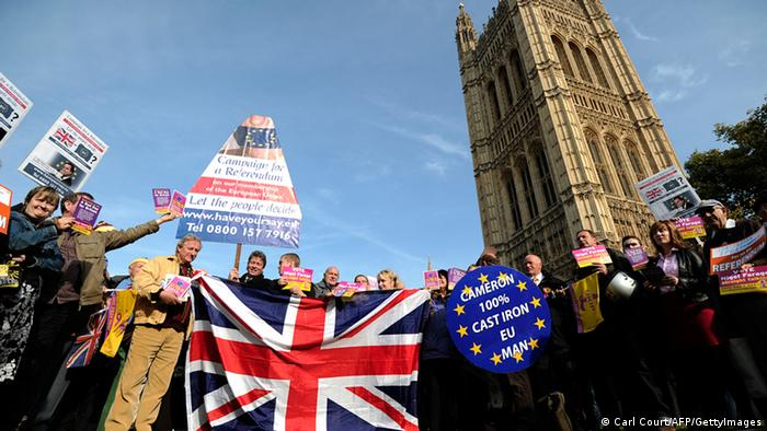 United Kingdom Independence Party (UKIP) supporters hold Union Jack flags and placards as they take part in a demonstration outside the Houses of Parliament in central London on October 24, 2011, the day that Parliament votes on whether to hold a referendum on the UK's membership of the European Union. David Cameron faced the biggest rebellion of his premiership today as eurosceptic backbenchers in his Conservative Party vowed to defy orders and vote for a referendum on Britain's EU membership. AFP PHOTO/ CARL COURT (Photo credit should read CARL COURT/AFP/Getty Images)