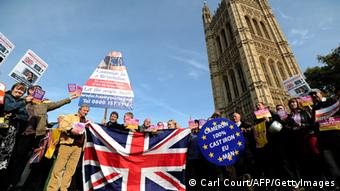 United Kingdom Independence Party (UKIP) supporters hold Union Jack flags and placards as they take part in a demonstration outside the Houses of Parliament in central London (Photo: CARL COURT/AFP/Getty Images)