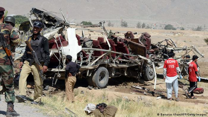 Pakistani policemen are pictured near the wreckage of a security forces vehicle following a bomb explosion on the outskirts of Quetta, the capital of restive Baluchistan province, on May 23, 2013. A bomb planted in a rickshaw tore through a vehicle used by security forces in southwest Pakistan on May 23, killing at least 12 people, police said. AFP PHOTO / BANARAS KHAN (Photo credit should read BANARAS KHAN/AFP/Getty Images)