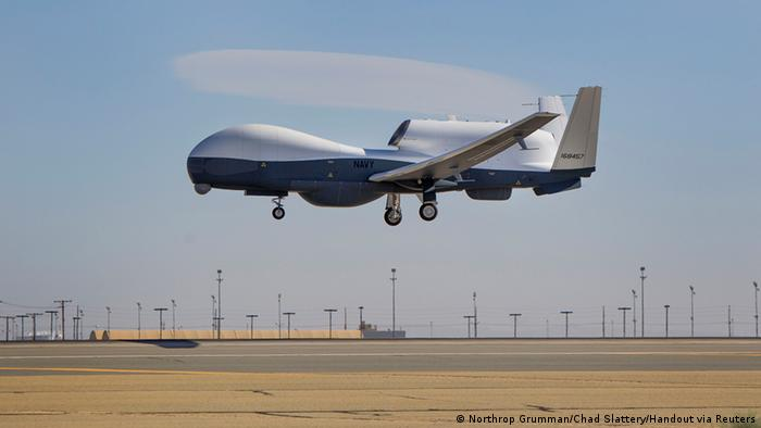 The Triton unmanned aircraft system is shown completing its first flight from the Northrop Grumman manufacturing facility in Palmdale, California