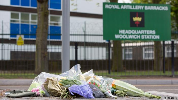 Floral tributes outside the Royal Military Barracks. Photo: REUTERS/Neil Hall.