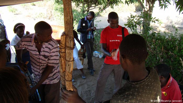 Felix Magul explains the female condom to onlookers