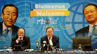 World Bank President Jim Yong Kim and UN secretary general Ban Ki-moon against a backdrop saying welcome in different languages (Photo: Junior D. Kannah/AFP/Getty Images)