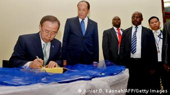 UN secretary general Ban Ki-Moon (L) signs a guestbook next to Congolese Senate president Leon Kengo Wa Dondo (2nd L) in the Parliament in Kinshasa on May 22, 2013. Ban Ki-moon wraps up a visit to Mozambique and arrives in Kinshasa on a key leg of his Africa trip centred on restoring peace in eastern Democratic Republic of Congo where a flareup in fighting over the past days has left 19 dead. AFP PHOTO/JUNIOR D.KANNAH (Photo credit should read Junior D. Kannah/AFP/Getty Images)