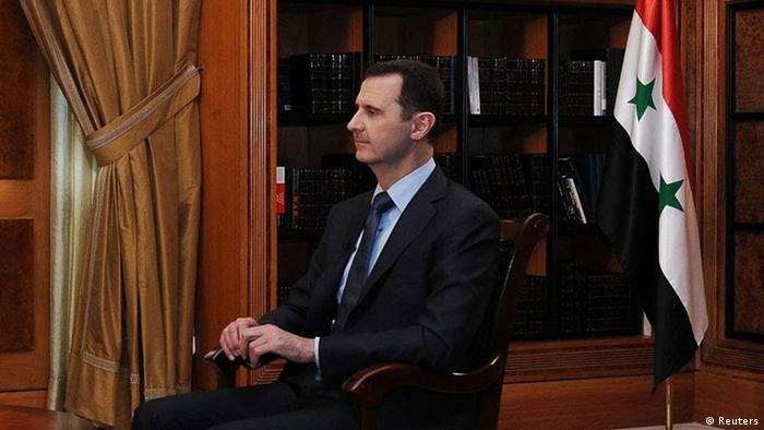 Syria's President Bashar al-Assad (R) sits during an interview with journalists from Argentina in Damascus in this handout photograph distributed by Syria's national news agency SANA on May 18, 2013. SANA/Handout via Reuters (SYRIA - Tags: POLITICS CONFLICT CIVIL UNREST MEDIA) ATTENTION EDITORS - THIS IMAGE WAS PROVIDED BY A THIRD PARTY. FOR EDITORIAL USE ONLY. NOT FOR SALE FOR MARKETING OR ADVERTISING CAMPAIGNS. THIS PICTURE IS DISTRIBUTED EXACTLY AS RECEIVED BY REUTERS, AS A SERVICE TO CLIENTS