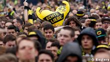 Borussia Dortmund fans cheer before a public viewing in downtown Dortmund May 25, 2013, of the Champions League soccer final between Bayern Munich and Borussia Dortmund at Wembley in London. REUTERS/Ina Fassbender (GERMANY - Tags: SPORT SOCCER)