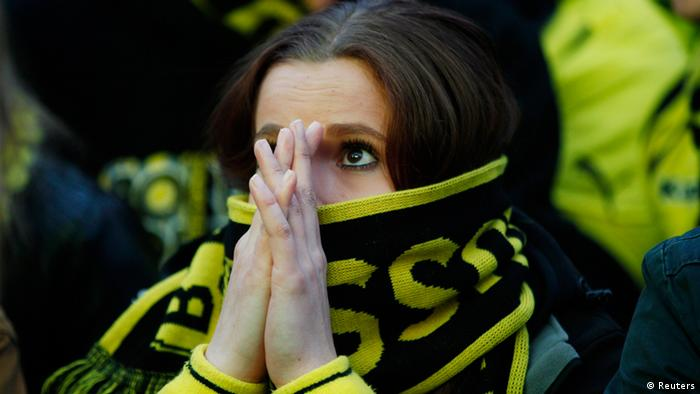 A Borussia Dortmund soccer fan reacts at a public viewing event in Dortmund May 25, 2013, during the Champions League Final soccer match between Bayern Munich and Borussia Dortmund at Wembley Stadium in London. REUTERS/Ina Fassbender (GERMANY - Tags: SPORT SOCCER)