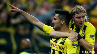 Borussia Dortmund's Ilkay Guendogan (L) celebrates with a team mate after scoring a penalty during their Champions League Final soccer match against Bayern Munich at Wembley Stadium in London May 25, 2013. REUTERS/Michael Dalder (BRITAIN - Tags: SPORT SOCCER)