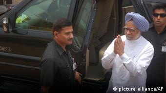 Indian Prime Minister Manmohan Singh, blue turban, arrives to attend a meeting to condole the death of victims of Saturday's Maoist attack at the Congress party office in Raipur, Chhattisgarh state, India, Sunday, May 26, 2013. Officials reacted with outrage Sunday to an audacious attack by about 200 suspected Maoist rebels who set off a roadside bomb and opened fire on a convoy carrying Indian ruling Congress party leaders and members in an eastern state, killing at least 24 people and wounding 37 others. (AP Photo)