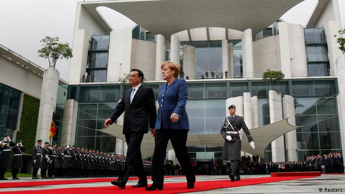German Chancellor Angela Merkel and Chinese Premier Li Keqiang review a guard of honour during a welcome ceremony at the Chancellery in Berlin (Photo via Reuters)