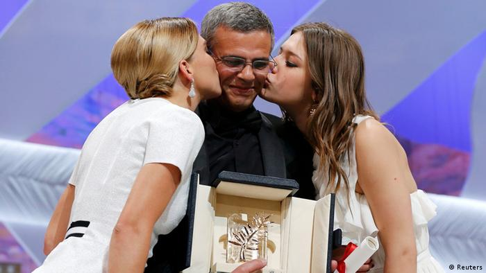 Actresses Lea Seydoux (L) and Adele Exarchopoulos (R) kiss director Abdellatif Kechiche (C) as they pose on stage after receiving the Palme d'Or award for the film La Vie D'Adele during the closing ceremony of the 66th Cannes Film Festival in Cannes May 26, 2013. REUTERS/Yves Herman (FRANCE - Tags: ENTERTAINMENT TPX IMAGES OF THE DAY)