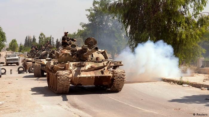 Forces loyal to Syria's President Bashar al-Assad are seen on a tank during what they said was an operation to occupy Dahra Abd Rabbo village in Aleppo, May 26, 2013. REUTERS/George Ourfalian (SYRIA - Tags: CONFLICT)