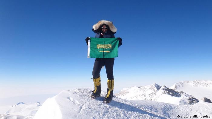epa03719837 A handout picture made available on 27 May 2013 and released by the mountaineer herself shows Saudi Raha Moharrak holding her national flag near the top of Mount Everest, Nepal, 17 May 2013. Moharrak and her teammates attended a press conference upon their arrival to the Gulf emirate of Sharjah, United Arab Emirates, 26 May 2013. The team who climbed the top of Everest mountain and had called themselves 'Arabs on Top of the World' consists of Raha Moharrak , first Palestinian man Raed Zidan, first Qatari man Sheikh Mohammed Al-Thani and youngest Iranian man Masoud Mohammad .They are trying to raise a million dollars for education projects in Nepal with Reach Out to Asia in this 60th anniversary year of the first climb of the summit. EPA/RAHA MOHARRAK HANDOUT EDITORIAL USE ONLY/NO SALES