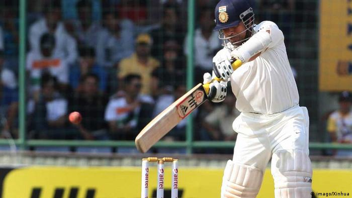 Indian batsman Sachin Tendulkar plays a shot during the second day of the 4th cricket test match between India and Australia in New Delhi, India, March 23, 2013.