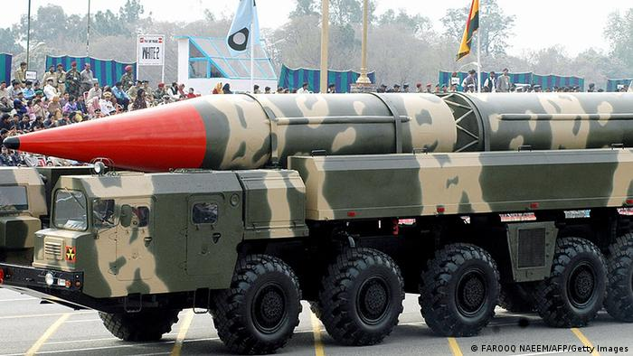 Pakistani spectators watch the Shaheen II long-range missile capable of carrying a nuclear warhead on its launcher during the National Day parade in Islamabad, 23 March 2005 (Photo: FAROOQ NAEEM/AFP/Getty Images)