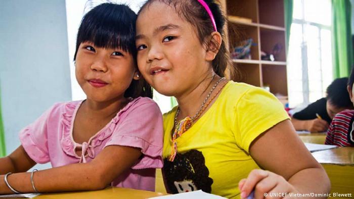 Two little vietnamese girls smiling. (Photo: UNICEF Vietnam/Dominic Blewett)