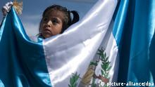 epa02918329 A girl holds a national flag at a parade to mark the 190th anniversary of the Guatemalan independence, in San Pedro Las Huertas, 45 km from Guatemala City, Guatemala, 15 September 2011. EPA/SAUL MARTINEZ