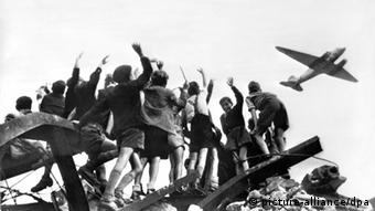 Boys in West Berlin celebrate the arrival of the candy bombers