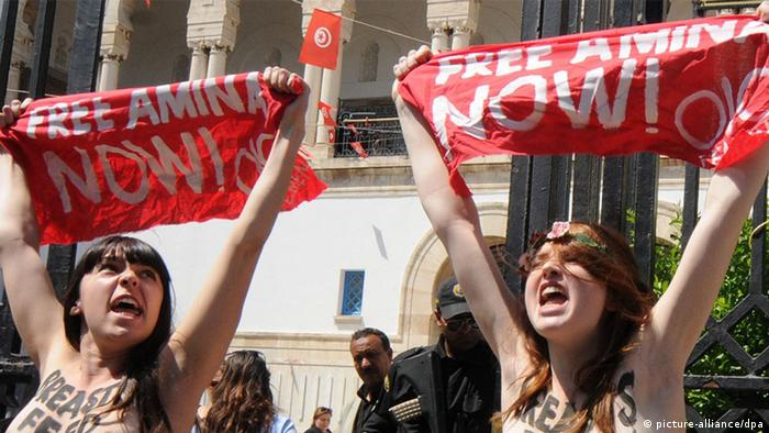Activists of the international feminist group Femen hold banners during a protest in front of the Ministry of Justice, in Tunis, Tunisia, 29 May 2013. According to media reports, three foreign activists gathered to protest the arrest of fellow Tunisian activist Amina Tyler earlier this month. (PhotoEPA/STR (c) dpa)