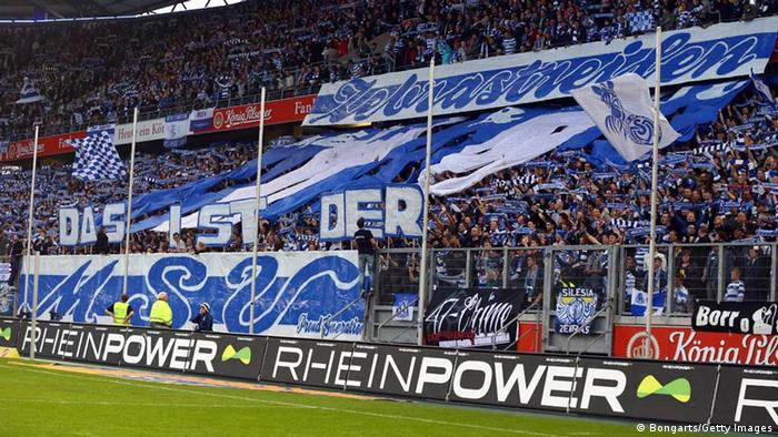 DUISBURG, GERMANY - APRIL 22: Fans of of Duisburg show a choreography prior to the Second Bundesliga match between MSV Duisburg and 1. FC Koeln at Schauinsland-Reisen-Arena on April 22, 2013 in Duisburg, Germany. (Photo by Christof Koepsel/Bongarts/Getty Images)