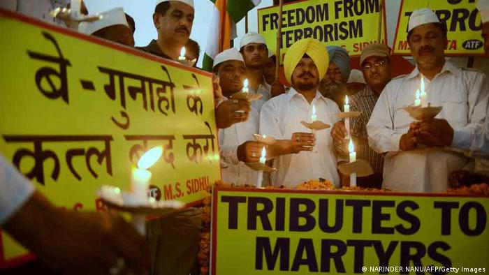 All-India Anti-Terrorist Front (AIATF) members hold a candlelight vigil as they pay tribute to Congress party members killed in a Maoist attack in the central state of Chhattisgarh, in Amritsar on May 27, 2013. (Photo: AFP)
