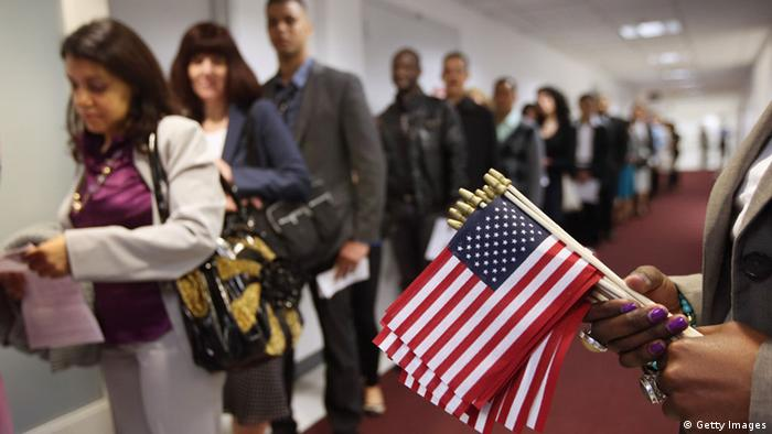 Immigrants wait to become American citizens ahead of a naturalization ceremony on May 17 in New York City. (Photo: John Moore/Getty Images)