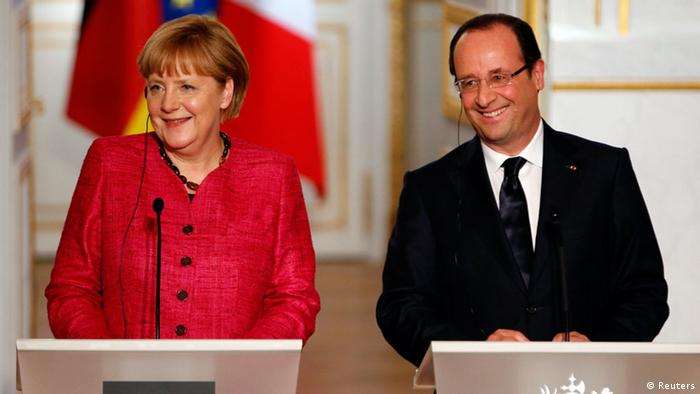 France's President Francois Hollande (R) and German Chancellor Angela Merkel attend a joint news conference at the Elysee Palace (Photo: REUTERS/Charles Platiau)
