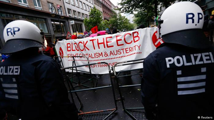 Police stand guard during an anti-capitalist Blockupy demonstration near the European Central Bank (ECB) headquarters in Frankfurt, (Photo: Reuters)