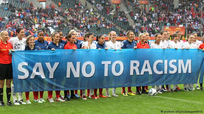 US womens national team holds up banner that reads say no to racism ahead of a World Cup game in Germany in 2011
