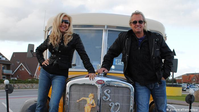 Robert and Carmen Geiss posing with an oldtimer car in Sylt in 2011