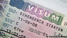 #31025476 - Close-up page of passport with Schengen visa © katatonia