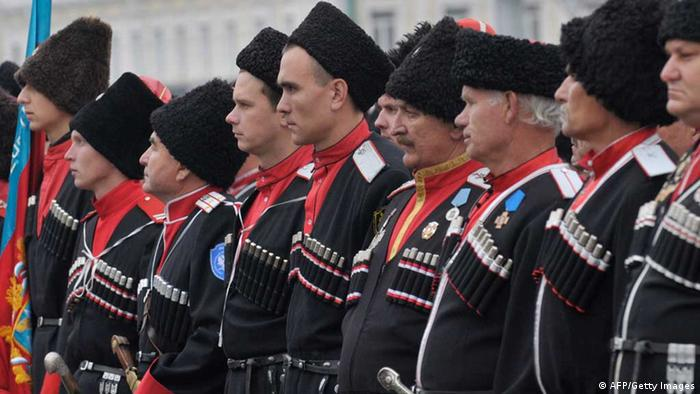 Wearing their traditional costumes Cossack gather for the regional Cossack community's inspection in the southern Russian city of Stavropol, on on November 17, 2012. Cossacks were mounted peasant-soldiers, who by the late 18th century became a privileged military class in Russia. There were 11 Cossack communities, each named for its location. AFP PHOTO / DANIL SEMYONOV (Photo credit should read DANIL SEMYONOV/AFP/Getty Images)