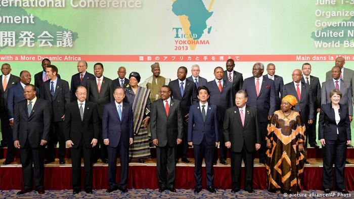 From front row, left to right, Swaziland King Mswati III, World Bank Group President Jim Yong Kim, U.N. Secretary-General Ban Ki-moon, Ethiopian Prime Minister Hailemariam Desalegn, Japanese Prime Minister Shinzo Abe, former Japanese Prime Mminister Yoshiro Mori and Nkosazana Dlamini-Zuma, Chairperson of the African Union Commission, and UNDP Administrator Helen Clark pose with other leaders of African countries during a photo session before the opening session of the Tokyo International Conference on African Development (TICAD) in Yokohama Saturday, June 1, 2013. (AP Photo/Kazuhiro Nogi, Pool)
