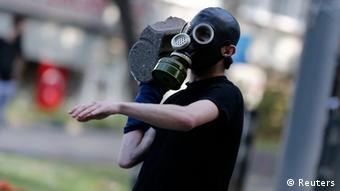 A protester prepares to throw a stone at riot police during an anti-government protest in central Istanbul June 1, 2013. Turkish police fired tear gas and water cannon for a second day on Saturday to prevent hundreds of protesters reaching the central Taksim Square, scene of violent protests in which hundreds were injured on Friday. REUTERS/Murad Sezer