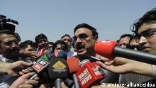 epa03726022 Sheikh Rasheed Ahmed, leader of Awami Muslim League, talks with journalists prior to taking oath at the National Assembly (lower house of the parliament) in Islamabad, Pakistan, 01 June 2013. Pakistan's new parliament on 01 June met for its inaugural session where the newly elected Members of National Assembly took oath. EPA/T. MUGHAL