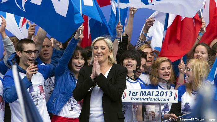 National Front (FN) party president Marine Le Pen gestures after her speech as part of the party's annual celebrations of Joan of Arc on May 1, 2013 on Paris' Opera square. AFP PHOTO / JOEL SAGET (Photo credit should read JOEL SAGET/AFP/Getty Images)