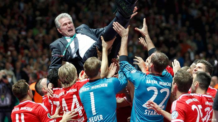 Bayern Munich's coach Jupp Heynckes celebrates with team their victory over VfB Stuttgart in their German soccer cup (DFB Pokal) final match at the Olympic Stadium in Berlin June 1, 2013. REUTERS/Tobias Schwarz (GERMANY - Tags: SPORT SOCCER TPX IMAGES OF THE DAY) DFB RULES PROHIBIT USE IN MMS SERVICES VIA HANDHELD DEVICES UNTIL TWO HOURS AFTER A MATCH AND ANY USAGE ON INTERNET OR ONLINE MEDIA SIMULATING VIDEO FOOTAGE DURING THE MATCH.