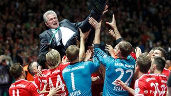 Bayern Munich's coach Jupp Heynckes celebrates with team their victory over VfB Stuttgart in their German soccer cup (DFB Pokal) final match at the Olympic Stadium in Berlin June 1, 2013. (Photo via REUTERS/Tobias Schwarz)