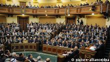 epa03519903 A Handout photograph released by the Egyptian Presidency shows President Mohamed Morsi (R) delivering a speech to Members of Parliament, at the Shura Council, in Cairo, Egypt, 29 December 2012. The newly adopted constitution allows the Shura Council to exercise legislative powers, which had temporarily been vested in the presidency, until a new lower house is elected. The constitution, drafted by an Islamist-led panel, was approved by 63.8 per cent of votes cast in a two-round referendum held this december. EPA/EGYPTIAN PRESIDENCY/HANDOUT HANDOUT EDITORIAL USE ONLY/NO SALES +++(c) dpa - Bildfunk+++