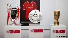 Bayern Munich's Champions League, Bundesliga and German Cup trophies are displayed before their team dinner in Berlin June 2, 2013. Bayern capped a spectacular season on Saturday by becoming the first German team to win the treble, holding on to beat VfB Stuttgart 3-2 in the German Cup final after the outsiders hit back in rousing style. REUTERS/Andreas Rentz/Pool (GERMANY - Tags: SPORT SOCCER)