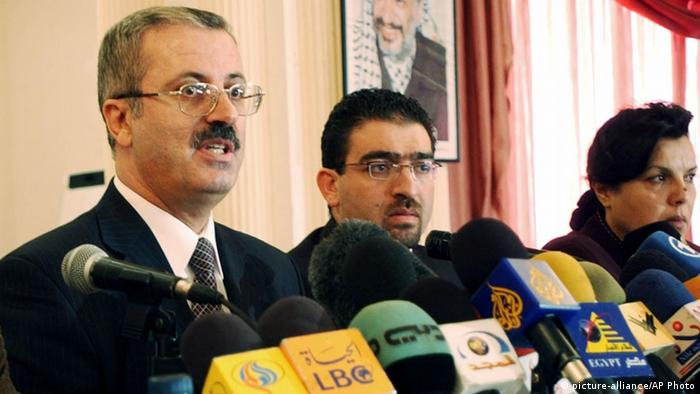 Rami Hamdallah, left, chairman of the Palestinian election committee, announces the list of 10 candidates qualified to run in Jan. 9 elections to replace the late Yasser Arafat as head of the Palestinian Authority, during a news conference in the West Bank city of Ramallah, Thursday, Dec. 2, 2004. The qualified candidates include Mahmoud Abbas, the interim Palestinian leader, jailed uprising leader Marwan Barghouti and democracy advocate Mustafa Barghouti. Others are unidentified.(AP Photo/Nasser Nasser)