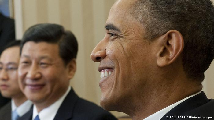 US President Barack Obama speaks alongside Chinese Vice President Xi Jinping (C) during meetings in the Oval Office of the White House in Washington, DC, February 14, 2012. (Photo: AFP)