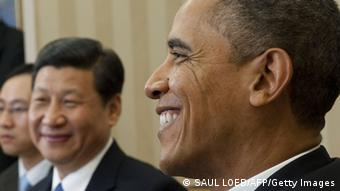 US President Barack Obama speaks alongside Chinese Vice President Xi Jinping (C) during meetings in the Oval Office of the White House in Washington, DC, February 14, 2012. Obama received the 58-year-old Chinese leader-in-waiting in the Oval Office, following Xi's meetings earlier in the day at the White House with Vice President Joe Biden and Secretary of State Hillary Clinton. AFP PHOTO / Saul LOEB (Photo credit should read SAUL LOEB/AFP/Getty Images)