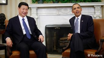 U.S. President Barack Obama (R) meets with China's Vice President Xi Jinping in the Oval Office of the White House in Washington, in this February 14, 2012 file photo. China will be attempting to meet charm with charm for the first time when new President Xi Jinping sheds his suit and tie for an unprecedented, informal summit with U.S. President Barack Obama in the California desert the week of June 3, 2013. REUTERS/Jason Reed/Files (UNITED STATES - Tags: POLITICS)