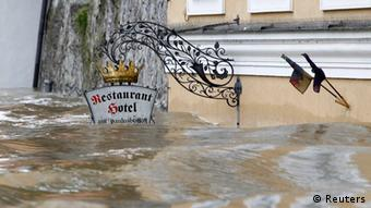 The sign above the door of restaurant and hotel 'Am Paulusbogen' is partially submerged in the flooded centre of the Bavarian town of Passau, about 200 km (124 miles) north-east of Munich June 3, 2013. Torrential rain in the south and south-east of Germany caused heavy flooding over the weekend, forcing people to evacuate their homes. REUTERS/Michaela Rehle (GERMANY - Tags: DISASTER ENVIRONMENT)